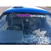 Tarzia Tyre Centre Window Banner White with Purple Insert